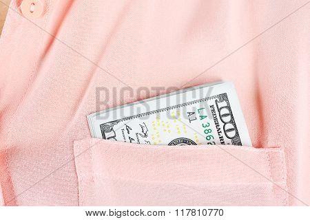 Money in pink shirt pocket, close up