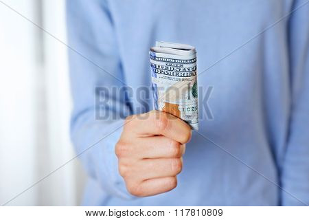 Hand holds money, close up