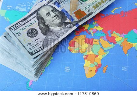 Cash on the world map background, close up