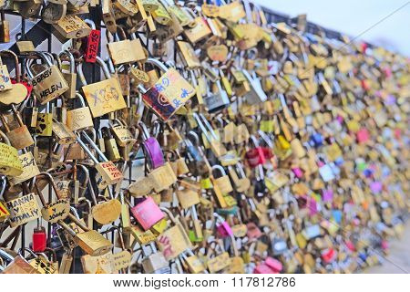 Paris, France, February 7 , 2016: Archbishop's Bridge in Paris, France, covered with love locks.