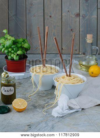 pasta spaghetti with pesto genovese marble background