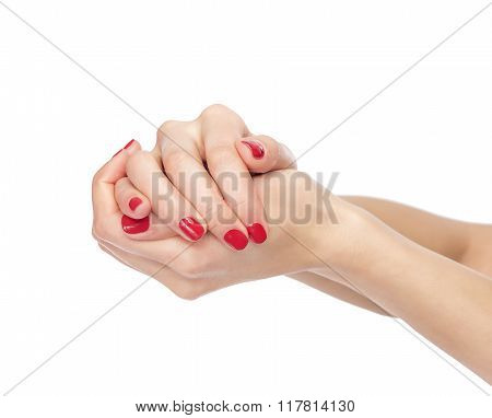 Women's clenched hands.