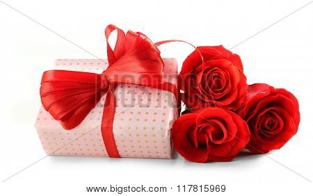 Gift box, rose flowers and decorative heart, isolated on white