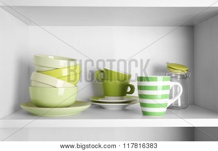 Tableware on shelf in the kitchen cupboard