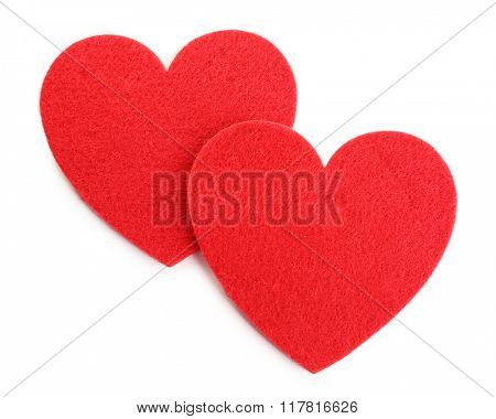 Red felt hearts isolated on white background