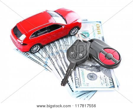New red car with keys and dollar banknotes, isolated on white