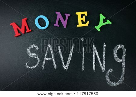 Money saving concept on a blackboard background