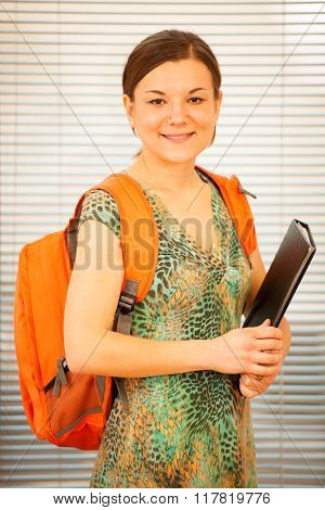 Adult Woman Representing Lifelong Learning. Woman With School Bag Smiling As A Gesture Of Happiness