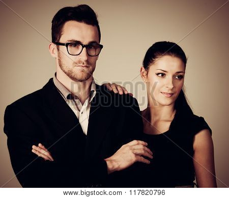 Confident Business Couple Standing Next To Each Other. Woman Leaning On Man Looking To The Future. C