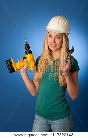Woman With Constructor Helmet And Tools Happy To Do Tough Work.