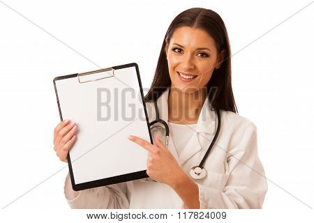 Woman Doctor With Stethoscope Around Neck Showing Clipboard With Blank Space For Note Or Advertise.
