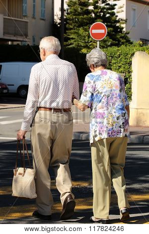 Senior Couple Walking In Town