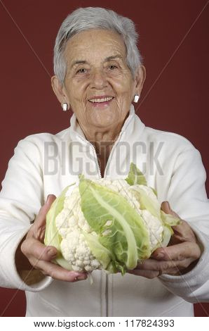 Senior Woman With a Cauliflower