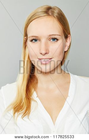 Head shot of young smiling blonde business woman
