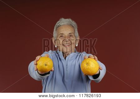 Senior Woman With Oranges