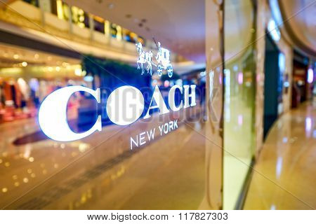 HONG KONG - JANUARY 27, 2016: Coach logo on the wall at Elements Shopping Mall. Coach, Inc. is an American luxury fashion company based in New York City