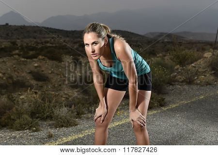 Young Exhausted Sport Woman Running Outdoors On Asphalt Road Stop For Breathing Tired