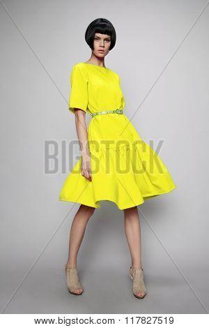 Brunette woman in yellow dress