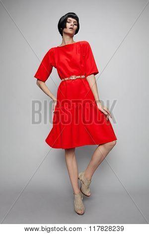 Brunette woman in red dress