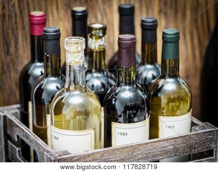Old wine bottles in a wooden crate.