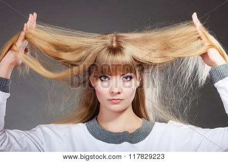Damaged Dry Hair. Woman Holding Hands Long Hair.