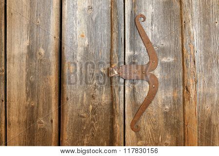 A wooden door made of barn wood with rustic vintage handle