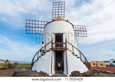 Young Woman Standing In A Traditional Spanish Windmill In Lanzarote,canary Islands, Spain
