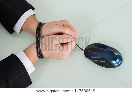Person Wrist Tied With Computer Mouse Cable