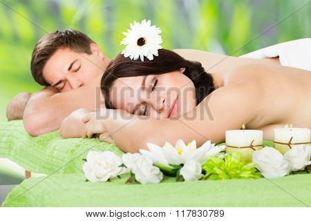 Relaxed Couple Lying At Beauty Spa