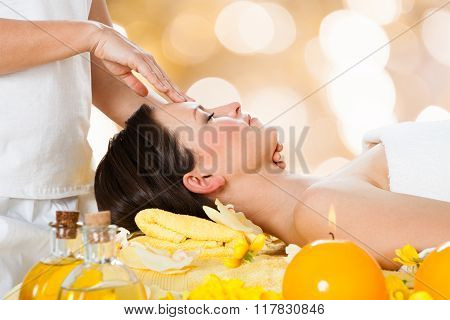 Woman Receiving Head Massage From Massager