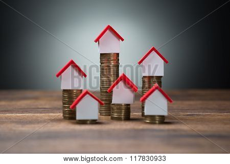 House Models On Stacked Coins