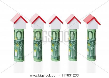 House Models Arranged On Rolled Euro Notes