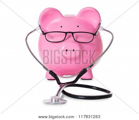Piggybank With Stethoscope And Eyeglasses