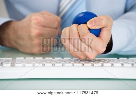 Businessman Pressing Stressball