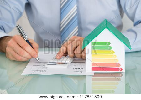Businessman Calculating Energy Efficiency Rate