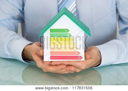 Businessman With House Model