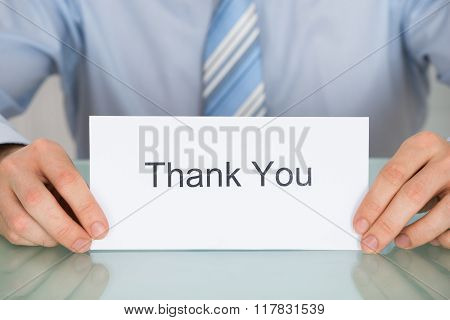 Businessman Holding Card With Thank You Text