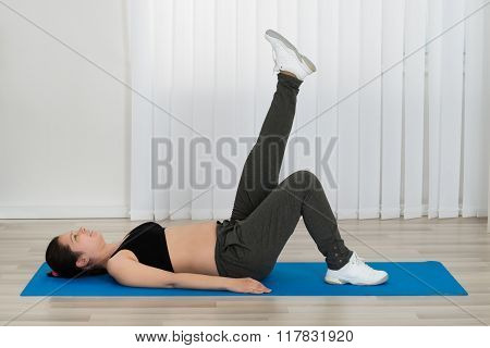 Pregnant Woman Exercising At Home