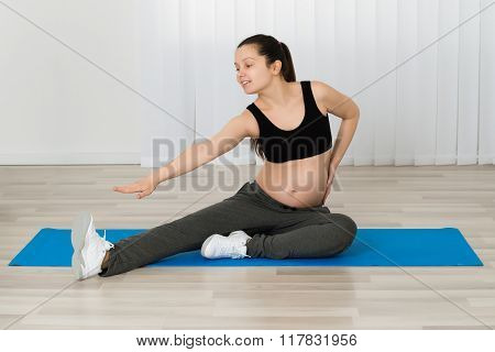 Pregnant Woman Stretching Her Leg