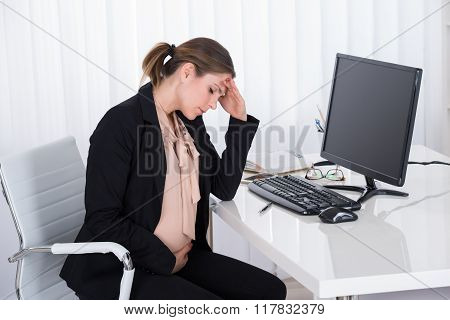 Pregnant Businesswoman Having Headache