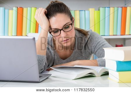 Tired Female Sitting In Library