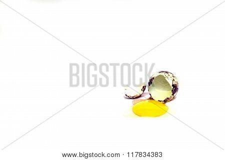 Quail Eggs Cracked On White Background