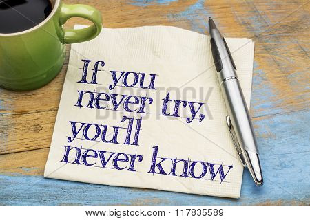 If you never try, you will never know. - Motivational handwriting on a napkin with a cup of coffee
