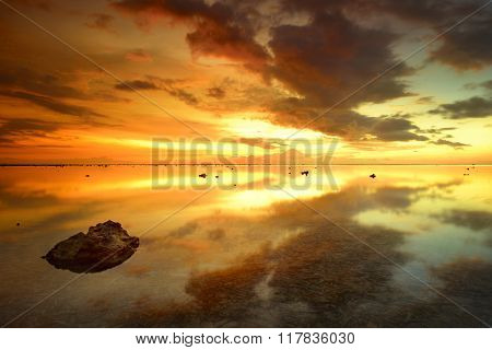 Beautiful sunset over the island of Bali Agung volcano on the background.