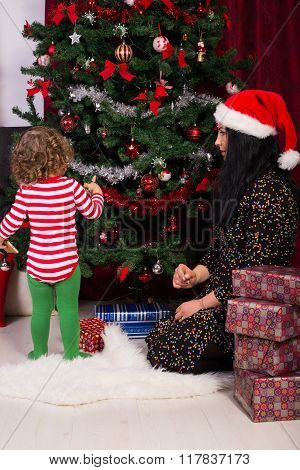 Mother And Son Decorating Tree