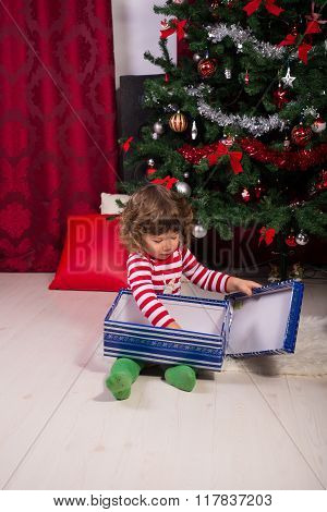 Toddler Opening Christmas Gifts