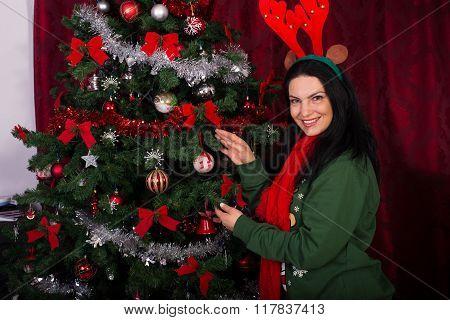 Happy Woman Decorating Christmas Tree