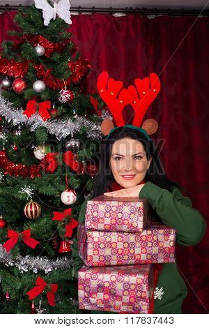 Cheerful Woman Holding Stack Of Presents