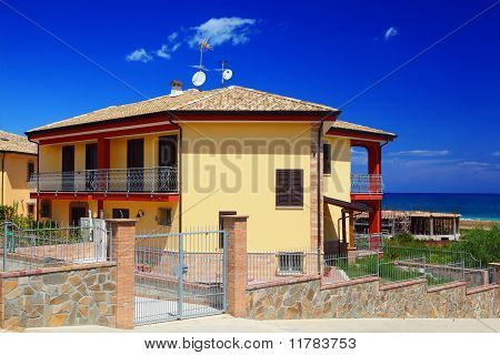 Fenced Yellow Two-story Cottage With Garden Snd Balcony On Coast