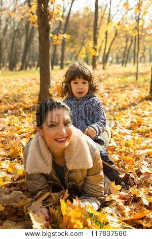 Mother And Son  Lay On Autumn Leaves